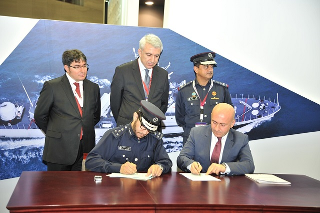 Deputy of Director Logistics Department, Brig. Abdullah Saad Al Kharji, representing the Ministry of Interior for the State of Qatar and Kerim Kalafatoglu, Chairman & Executive Director for ARES Shipyard signing the Memorandum of Understanding during DIMDEX 2014