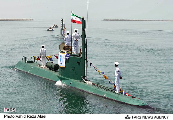 Iran launched a semi-heavy submarine in a bid to boost its naval capabilities in the high seas, Iranian Defense Minister Brigadier General Hossein Dehqan announced. Iran launched the largest submarine it has ever built into the Gulf & is building a second according to satellite. This is the first time that the Fateh-class submarines that Iran has said it is building have been seen. The first submarine can be seen in the water at the Bostanu shipyard on the Strait of Hormuz in satellite imagery. A second submarine can be seen under construction at the Bandar Anzali Naval Base on the Caspian Sea in Iran in September.
