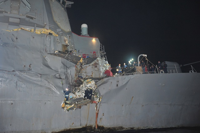 One of the U.S. Navy's guided-missile destroyers, USS Porter (DDG 78) suffered some damage after colliding with an oil tanker early Sunday in the strategic Strait of Hormuz. No personnel on either vessel were reported injured.