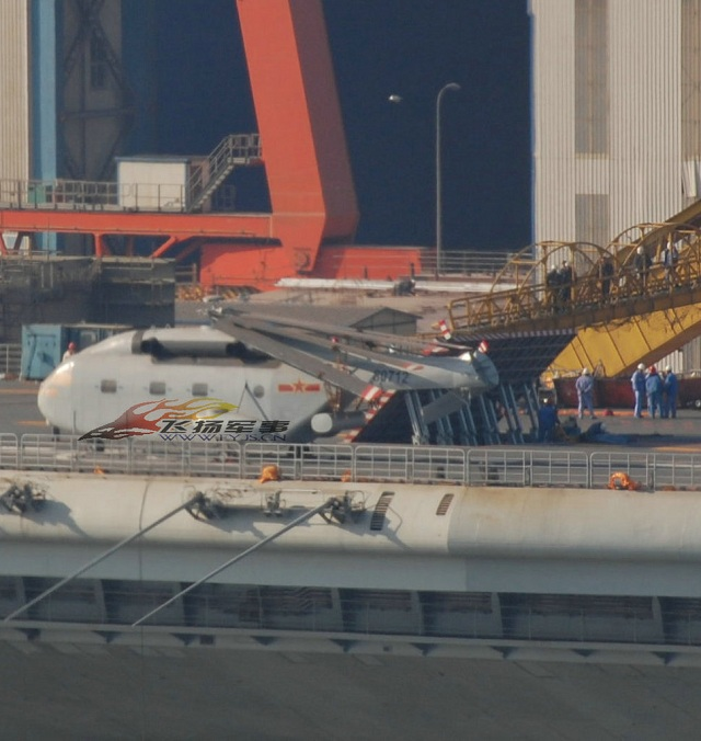 Photographs have emerged on the Chinese internet showing what seems to be a J-15 jet parked on the flight deck of the former Varyag aircraft.