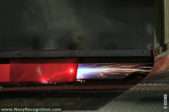 8 October 2009: Laser cutter cuts first plate for FREMM frigate Normandie