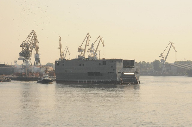The stern of the Russian Navy's first Mistral-class helicopter carrier was floated out on Wednesday, a Russian shipyard said. The Vladivostok is to enter service with the Russian Navy next year, Baltiisky shipyard chief Alexander Voznesensky said.