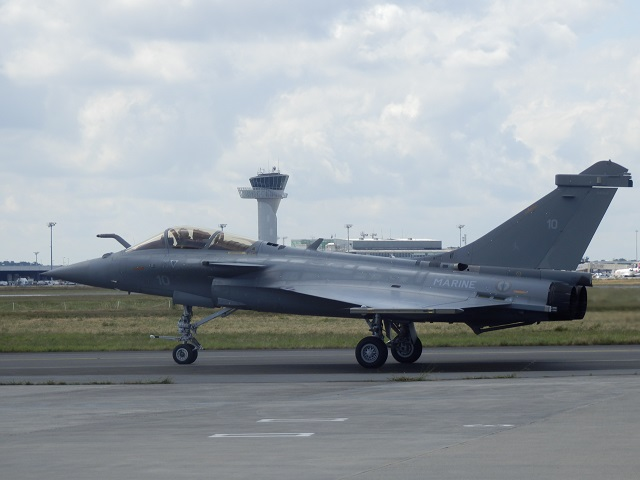 "On Friday, 3 October, the Dassault Aviation plant in Mérignac (France) delivered to the French defense procurement agency (DGA) the Rafale M10, the first of a tranche of ten retrofitted Rafale ""Marine"" (Navy) aircraft. These ten Rafale aircraft (M1 to M10) were produced from the late 1990s to replace the F-8 Crusaders aircraft that provided air defense for the French navy since 1964. As this replacement could not wait for the service entry of the versatile F2 and F3 standards, the ten Rafale Marine were provided with a so-called basic F1 standard, limited to superiority and air defense missions only."