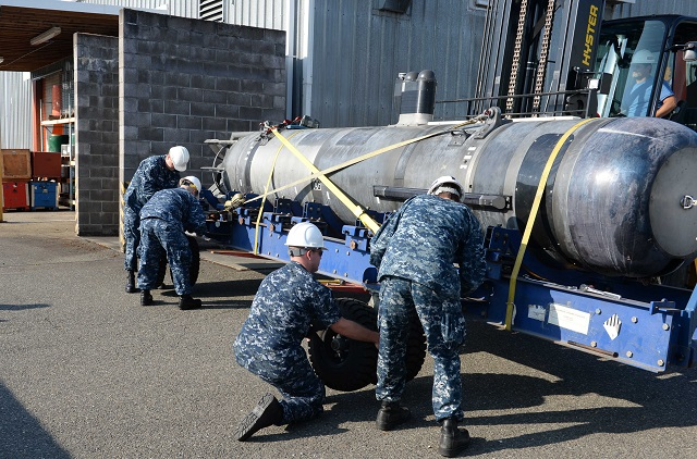 Commander, Submarine Development Squadron 5 (CSDS 5), Detachment UUV, took delivery of Large Training Vehicle 38 (LTV 38), an unmanned undersea vehicle (UUV) Aug. 22. The delivery makes LTV 38 the first UUV to join the vehicle inventory used by detachment UUV at Naval Undersea Warfare Center Keyport.
