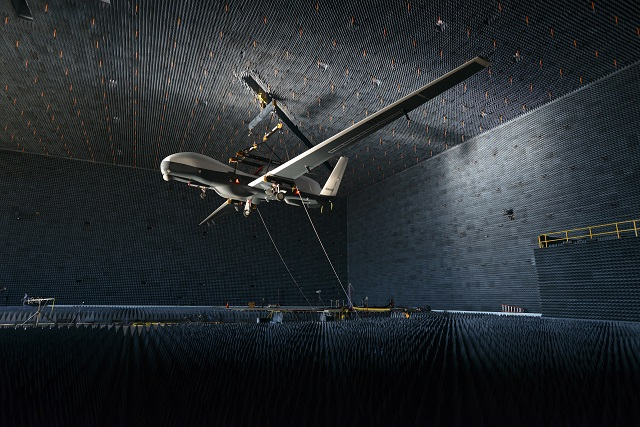 A U.S. Navy MQ-4C Triton UAS was lifted inside Patuxent River's anechoic chamber Aug.12 for electromagnetic compatibility (EMC) testing. This event marked the first time that an unmanned aircraft inside the chamber was controlled from an external ground control station. Triton's EMC testing will continue for the next eight weeks to verify the aircraft's subsystems can operate without interfering with each other.