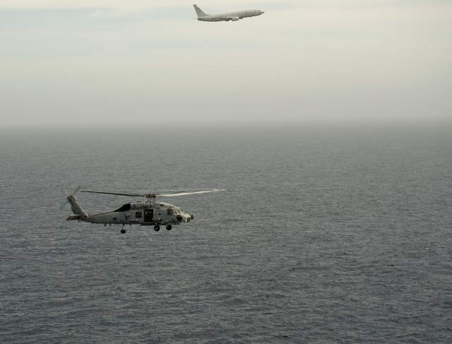 A P-8A Poseidon aircraft assigned to Patrol Squadron (VP) 8 conducts the first West Coast integrated Anti-Submarine Warfare (ASW) training exercise with an MH-60R helicopter from Helicopter Maritime Strike Squadron (HSM) 75 in the Southern California operating area on April 30, 2015. After the US, Australia will become the second nation to deploy the P-8A Poseidon with the MH-60R Romeo for Anti-Submarine Warfare and Anti-Surface Warfare missions.