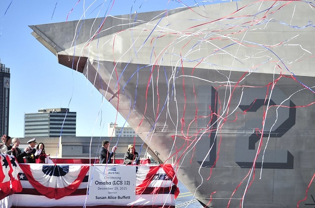 MOBILE, Ala. (Dec. 19, 2015) Susan A. Buffett, ship's sponsor for the littoral combat ship Pre-Commissioning Unit, Omaha (LCS 12), breaks a bottle across the ship's bow during a christening ceremony at Austal USA shipyard in Mobile, Ala. (U.S. Navy photo by Mass Communication Specialist 1st Class Michael C. Barton/Released)