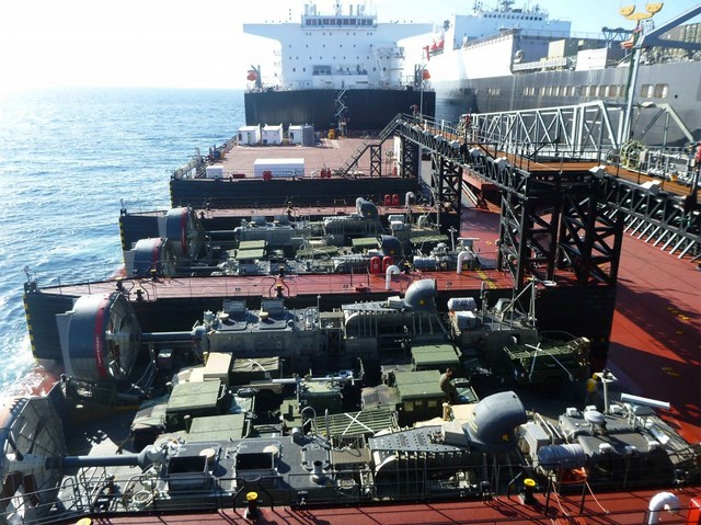 USMC Vehicles transit from Dahl on to Montford Point and are loaded on two LCACs which will deliver the equipment ashore during the Pacific Horizon 2015 exercise.