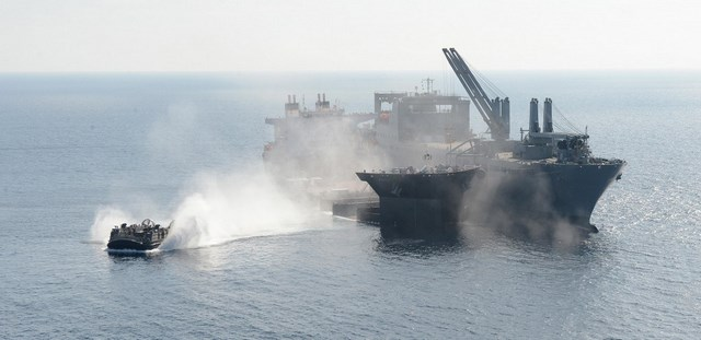 LCACs are used to transfer equipment and vehicles to and from the ship to the shore.An LCAC transports an LVSR ashore during offload operations.
