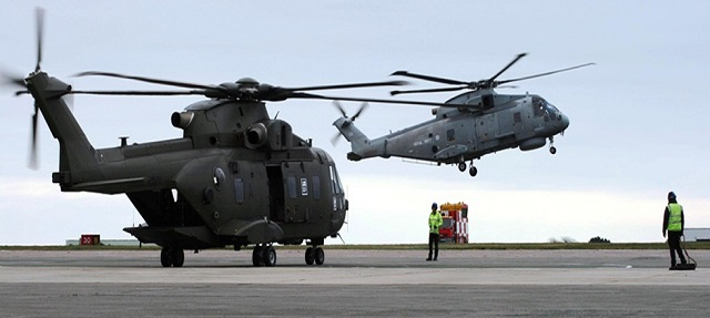 "A ""green"" Merlin Mk3 (foreground) and a ""grey"" Merlin Mk2 (background). The AgustaWestland Merlin Mk2 is the anti-submarine warfare and maritime surveillance helicopter of the Royal Navy. The Mk3 variant was transfered from the Royal Air Force to the Royal Navy to take on the demanding Commando Role (from ship to shore operations). The current Merlin Mk3 fleet will undergo an upgrade package through an interim model. It will then move towards the advanced Merlin Mk4."