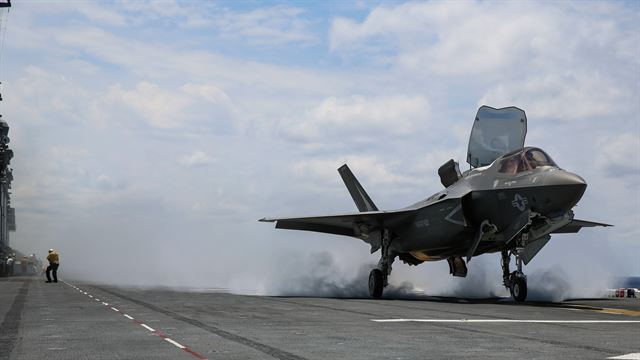 An F-35B Lightning II takes off on the flight deck of USS Wasp (LHD-1) during routine daylight operations, a part of Operational Testing 1, May 22. The F-35B is the future of Marine Corps aviation and will be replacing three legacy platforms: The AV-8B Harrier, the F/A Hornet and the EA-6B Prowler. The F-35B is with Marine Fighter Attack Training Squadron 501, Marine Aircraft Group 31, 2nd Marine Aircraft Wing.