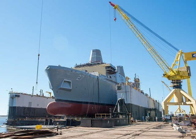 The future USS Portland (LPD 27) was successfully launched at the Huntington Ingalls Industries (HII) shipyard Feb. 13. The ship was transferred from the land level facility to the drydock, which was then flooded allowing her to float off the blocks.