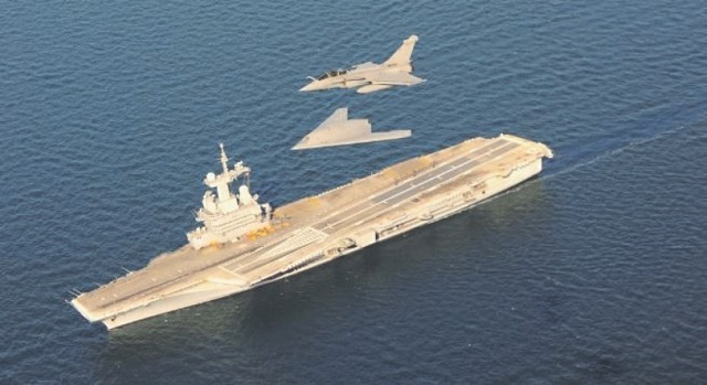 The nEUROn unmanned combat aerial vehicle (UCAV) demonstrator made several low altitude vertical passes above French Navy (Marine Nationale) aircraft carrier Charles de Gaulle. These tests which took place July 6, 2016 were conducted by the French Procurement Agency (DGA) in conjunction with the French Navy and Dassault Aviation. They are part of a test campaign which objective is to study the use of a UCAV in a naval environment involving several vessels of the French Navy.