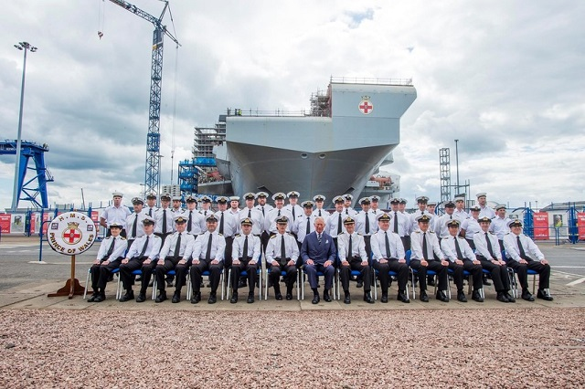 The second of the largest warships ever built for the Royal Navy, the Queen Elizabeth Class carrier HMS PRINCE OF WALES, was given the royal seal of approval when HRH The Prince of Wales, (or Duke of Rothesay as he is referred to in Scotland), visited Babcock's Rosyth Facilities and signalled for the final section to be lowered into place.