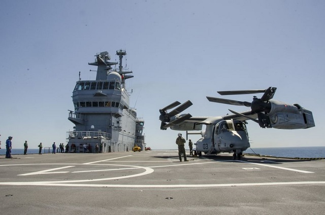 "The French Navy (Marine Nationale) announced that it took another step in the interoperability between the V-22 Osprey and the Mistral-class LHD Dixmude on May 2nd 2016. While V-22s have been tested with the Mistral class several times to date (they were even officially qualified with the Mistral-class last year) it is the first time that the Bell-Boeing tilt-rotor aircraft was qualified for ""blades and wings folding and long time parking"" aboard the French Navy LHD."