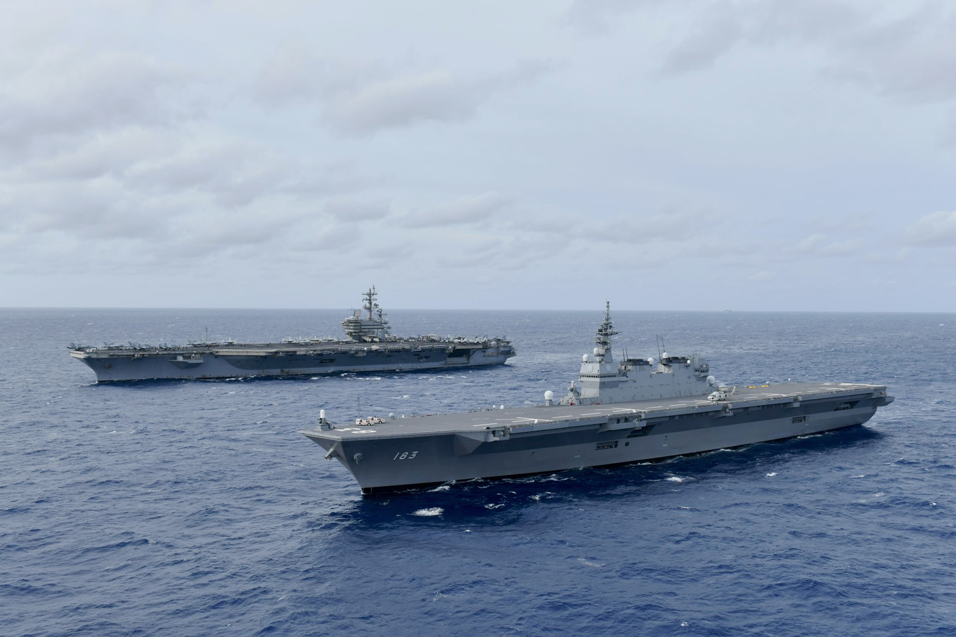 USS Ronald Reagan and JS Izumo sail together in the South China Sea