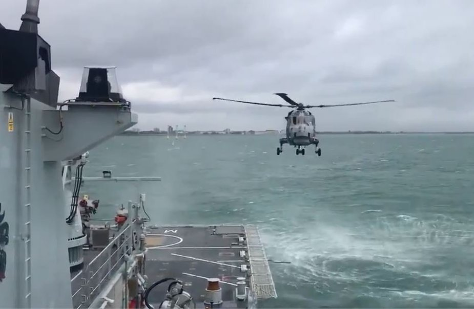 Royal Navy helicopter landing on patrol boat for first time 925 001