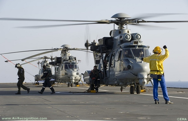 French Air Force Eurocopter Caracal (EC775) Combat Seach and Rescue (CSAR) helicopters getting ready on French Navy's Mistral BPC deck.