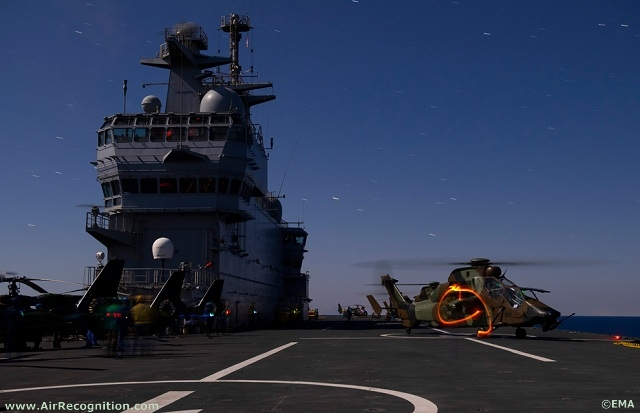 French Army Eurocopter Tigre and Gazelle helicopters getting ready on French Navy's Mistral BPC deck for a night mission over libyan territory.