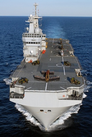 Designed by DCNS, Mistral BPC (Bâtiment de Projection et de Commandment) LHD is a multi-mission 21,500t amphibious assault, command and power projection ship. Mistral-class vessels are capable to accomodate and deploy 16 transport or attack helicopters, four landing crafts, up to 70 vehicles or 13 main battle tanks. They have accomodations for 450 to 700 troops. Each ship of the class is equipped with a 69-bed hospital.