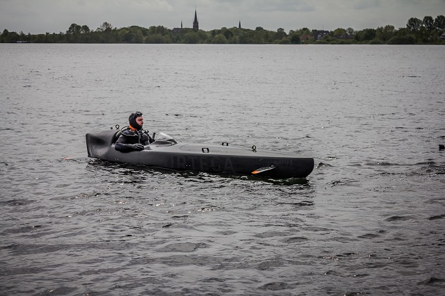 "At the UDT 2015 Undersea Defence Technology exhibition and conference, Dutch company Ortega Submersibles showcased its Ortega Mk. 1C three-person electric submersible boat for special forces. It was inspired by the ""Sleeping Beauty"", a motorised submersible canoe built by British Special Operations Executive during World War II as an underwater vehicle for a single frogman to perform clandestine reconnaissance or attacks against enemy vessels."
