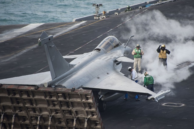 A Rafale M aircraft, assigned to the French aircraft carrier Charles de Gaulle, prepares to launch from the aircraft carrier USS Harry S. Truman (CVN 75) during carrier qualification integration.