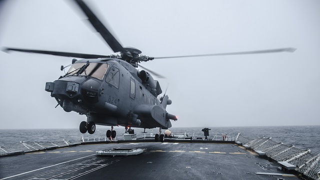 A CH-148 Cyclone helicopter practices landing procedures on Her Majesty's Canadian Ship Halifax off the coast of Nova Scotia on January 27, 2016