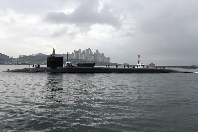 The Ohio-class guided-missile submarine USS Michigan (SSGN 727) (Blue) arrived at Busan, April 25, for a routine visit during a regularly scheduled deployment to the Western Pacific. During the visit Sailors will experience the culture and history of the ROK, as well as foster outstanding relations between the U.S. Navy, ROK military and the local Busan community.