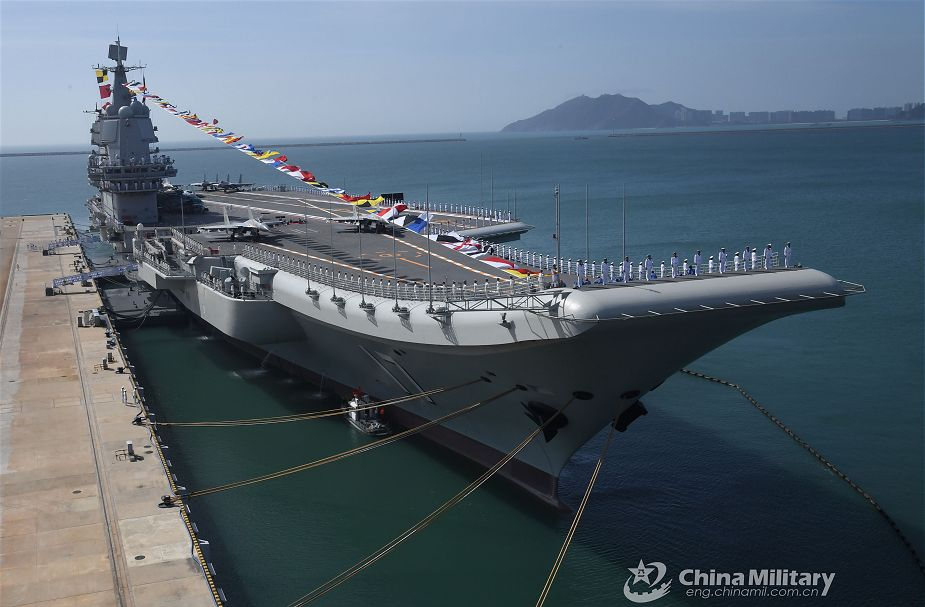 China releases first pictures of Shandong Chinese made aircraft carrier a naval port in Sanya 925 001